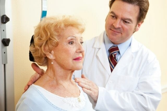 old woman consulting a doctor for her pinched nerve problems